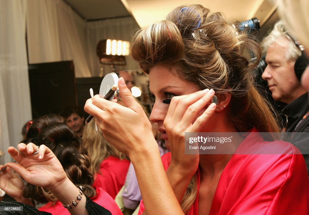 Model Gisele Bundchen prepares backstage for The Victoria's Secret Fashion Show at the 69th Regiment Armory November 9, 2005 in New York City.
