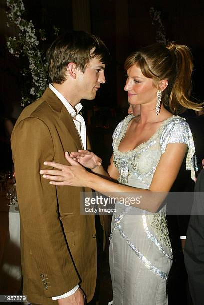 Model Gisele Bundchen talks with actor Ashton Kutcher during the Costume Institute Benefit Gala sponsored by Gucci April 28 2003 at The Metropolitan...