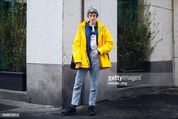 Model Gisele Fox wears a 'Local Myth Pizza' beanie yellow rain jacket blue down jacket white Fendi tshirt blue/gray pants and black sneakers during...