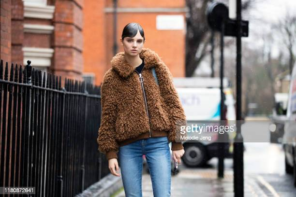 Model Giselle Norman wears a brown fuzzy teddy bear jacket and jeans after the J.W. Anderson show during London Fashion Week February 2019 on...
