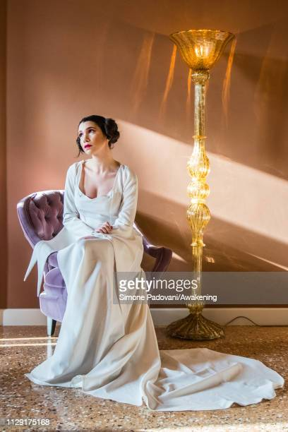 Model Giulia Boscolo wears a white dress with long train inspired by Princess Leila of Star Wars for the 2019 edition of Venice Carnival on February...