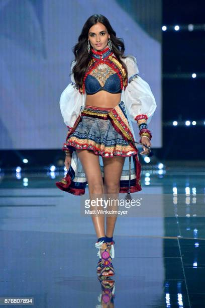 Model Gizele Oliveira walks the runway during the 2017 Victoria's Secret Fashion Show In Shanghai at MercedesBenz Arena on November 20 2017 in...