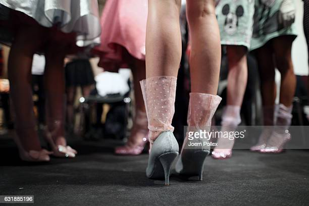 Model, glove detail, is seen backstage ahead of the Lena Hoschek show during the Mercedes-Benz Fashion Week Berlin A/W 2017 at Kaufhaus Jandorf on...