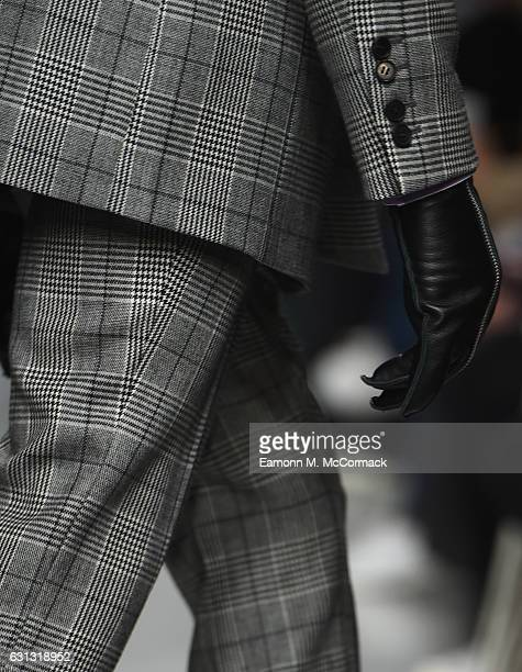 Model, glove detail, walks the runway at John Lawrence Sullivan during London Fashion Week Men's January 2017 collections at BFC Show Space on...