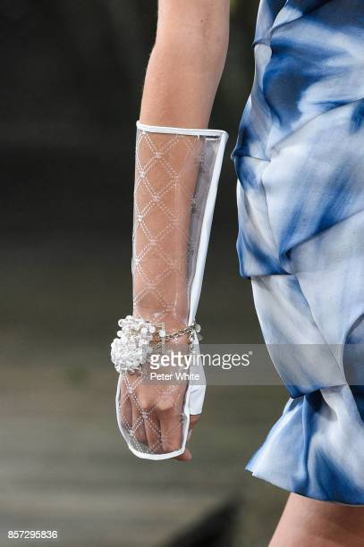 A model glove detail walks the runway during the Chanel fashion show as part of the Paris Fashion Week Womenswear Spring/Summer 2018 on October 3...