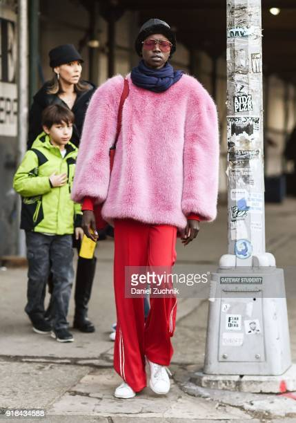 Model Grace Bol is seen wearing pink fur coat and Adidas red pants outside the Esteban Cortazar show during New York Fashion Week Women's A/W 2018 on...