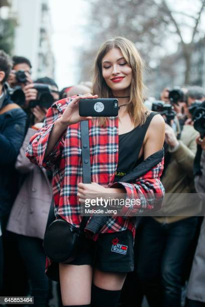 Model Grace Elizabeth takes a photo of the photographers outside Dolce Gabbana during Milan Fashion Week Fall/Winter 2017/18 on February 26 2017 in...