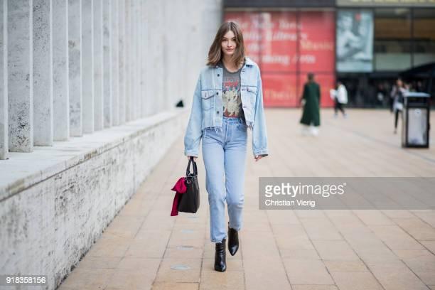 Model Grace Elizabeth wearing denim jacket denim pants seen outside Michael Kors on February 14 2018 in New York City