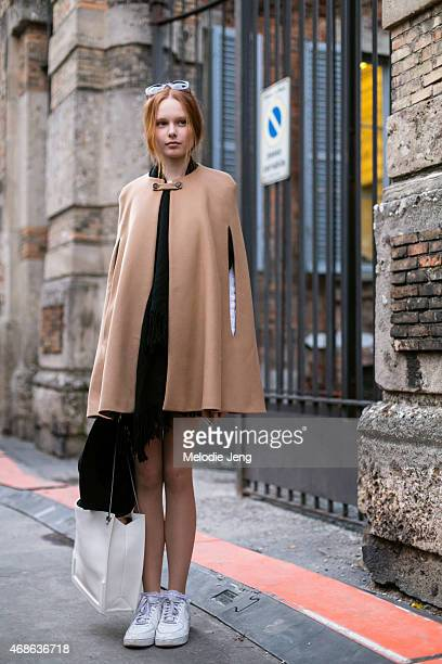 Model Grace Simmons exits the Alberta Ferretti show in a Marc Jacobs cape Safilo sunglasses and Nike sneakers on Day 1 of Milan Fashion Week FW15 on...
