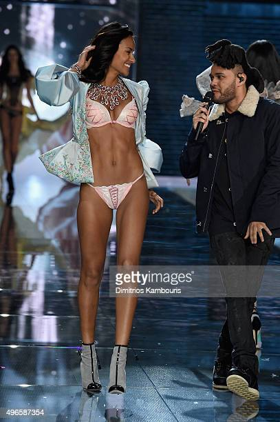 Model Gracie Carvalho from Brazil walks the runway while singer The Weeknd performs during the 2015 Victoria's Secret Fashion Show at Lexington...