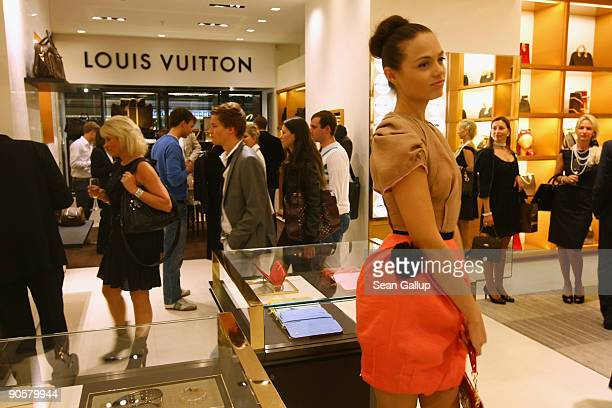 A model greets shoppers at the Louis Vuitton luxury store during the Vogue Fashion's Night Out at the KaDeWe department store on September 10 2009 in...