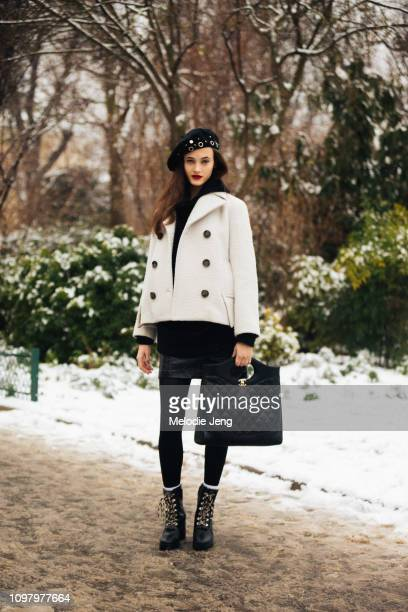Model Greta Varlese wears a black beret white cropped jacket and Chanel bag after the Chanel show during Couture Fashion Week Spring/Summer 2019 on...
