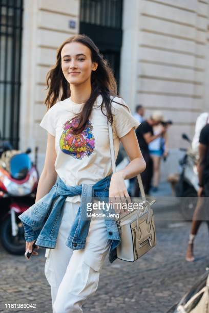 Model Greta Varlese wears a tan Leo t-shirt and Celine bag after the Zuhair Murad show during Couture Fashion Week Fall/Winter 2019 on July 03, 2019...