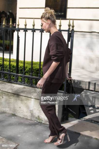 Model Hailey Baldwin leaves the 'Montaigne Market' store on Avenue Montaigne on March 27 2017 in Paris France
