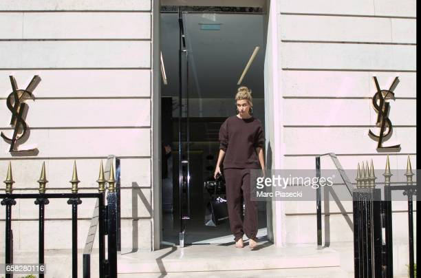 Model Hailey Baldwin leaves the 'Yves Saint Laurent' store on Avenue Montaigne on March 27 2017 in Paris France