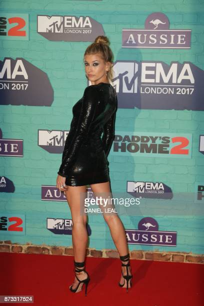 US model Hailey Baldwin poses on the red carpet arriving to attend the 2017 MTV Europe Music Awards at Wembley Arena in London on November 12 2017 /...