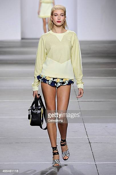 Model Hailey Baldwin walks the runway at the Topshop Unique Red Label Spring Summer 2015 fashion show during London Fashion Week on September 14 2014...