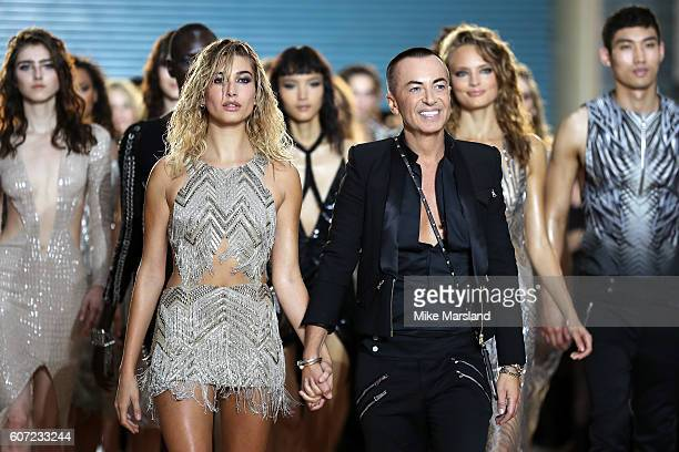 Model Hailey Baldwin walks with designer Julien Macdonald on the runway at the Julien Macdonald show during London Fashion Week Spring/Summer...