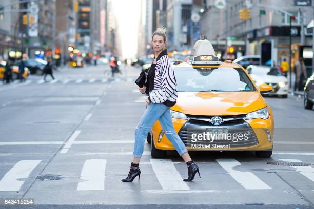 Model Hailey Clauson is seen wearing Citizens by Humanity jeans Kendall Kylie bodysuit and Saint Laurent boots and bag in midtown on February 20 2017...