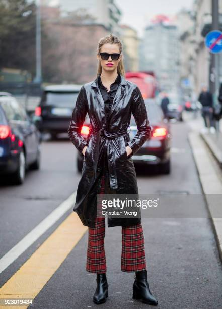 Model Hailey Clauson wearing black vinyl coat seen during Milan Fashion Week Fall/Winter 2018/19 on February 22 2018 in Milan Italy