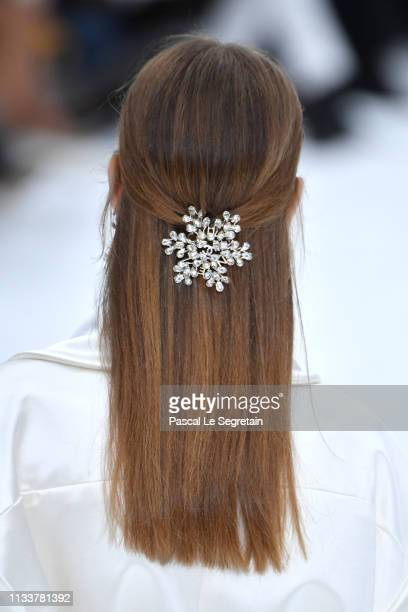 A model hair accessory detail walks the runway during the Chanel show as part of the Paris Fashion Week Womenswear Fall/Winter 2019/2020 on March 05...