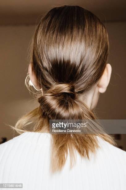 Model, hair deatail, poses backstage at the Simona Marziali - MRZ fashion show during the Milan Women's Fashion Week on September 23, 2020 in Milan,...