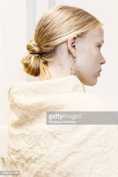 A model hair detail is seen backstage ahead of the Aalto show during Milan Men's Fashion Week Spring/Summer 2019 on June 18 2018 in Milan Italy