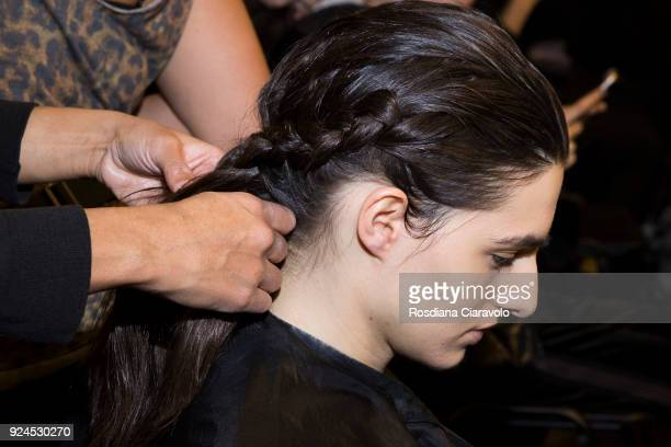 A model hair detail is seen backstage ahead of the Gabriele Colangelo show during Milan Fashion Week Fall/Winter 2018/19 on February 24 2018 in Milan...