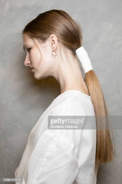 A model hair detail is seen backstage ahead of the Les Copains show during Milan Fashion Week Spring/Summer 2019 on September 22 2018 in Milan Italy