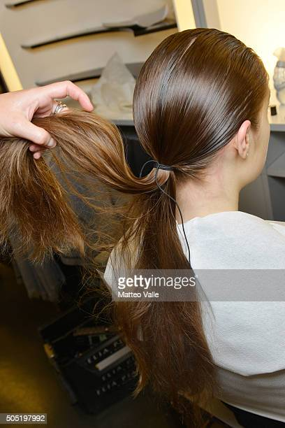 A model hair detail is seen backstage ahead of the Lucio Vanotti show during Milan Men's Fashion Week Fall/Winter 2016/17 on January 16 2016 in Milan...