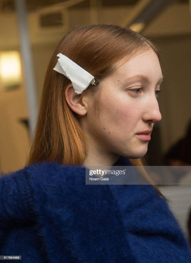 A model, hair detail, poses backstage at the Gabriela Hearst fashion show during New York Fashion Wee on February 13, 2018 in New York City.