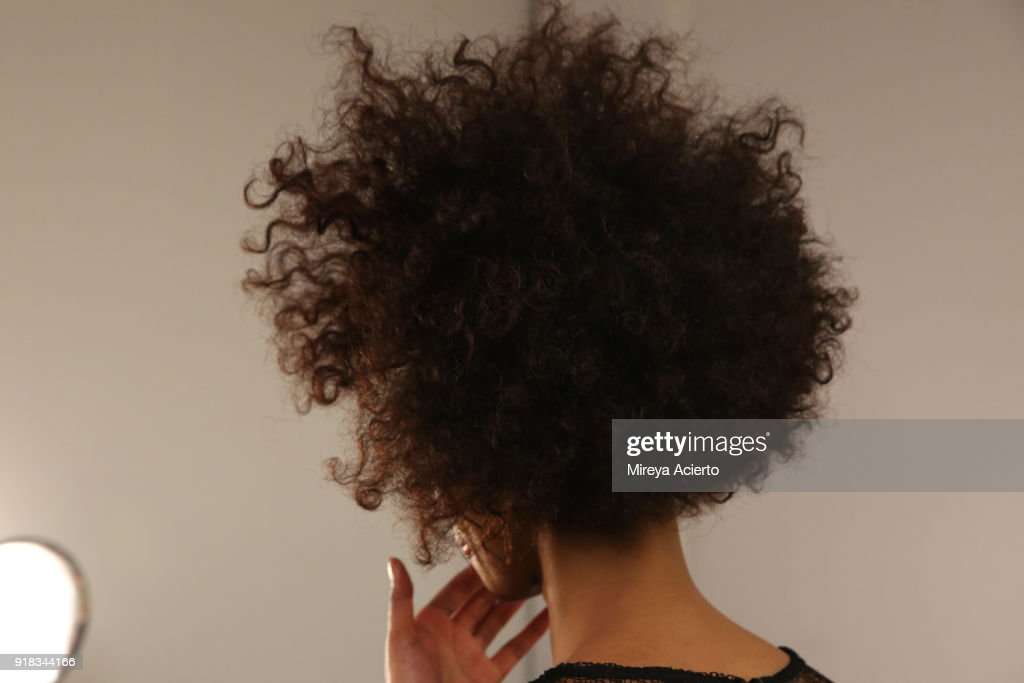 A model, hair detail, prepares backstage for Irina Vitjaz during New York Fashion Week: The Shows at Gallery I at Spring Studios on February 14, 2018 in New York City.