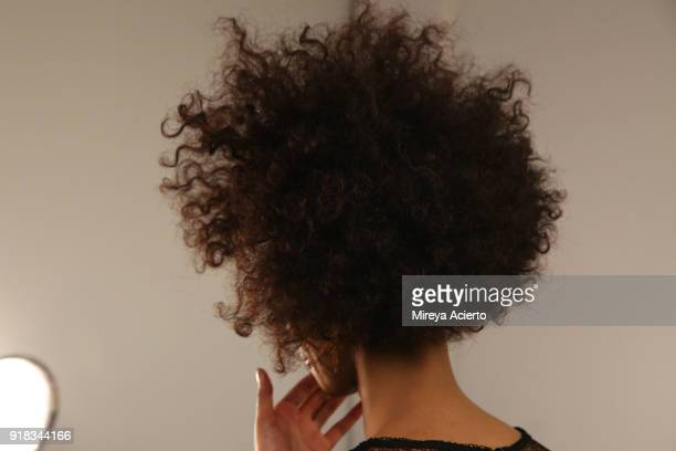 A model hair detail prepares backstage for Irina Vitjaz during New York Fashion Week The Shows at Gallery I at Spring Studios on February 14 2018 in...