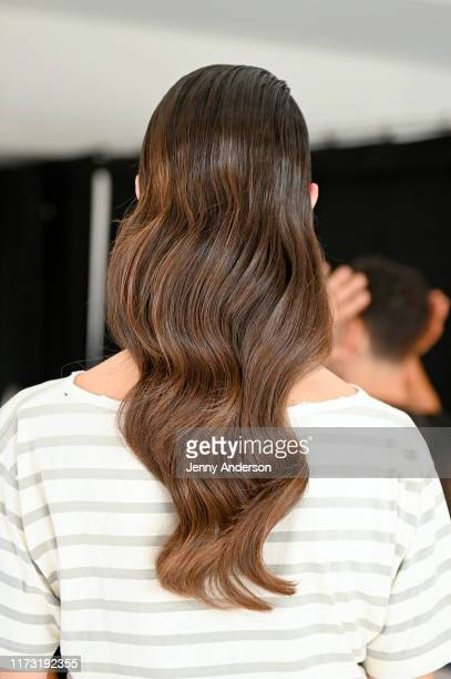 A model hair detail prepares backstage for Raisavanessa during New York Fashion Week The Shows at Gallery I at Spring Studios on September 08 2019 in...