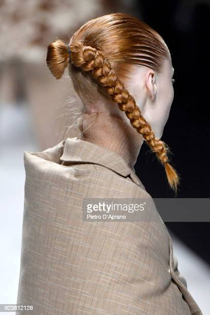 A model hair detail walks the runway at the Jil Sander show during Milan Fashion Week Fall/Winter 2018/19 on February 24 2018 in Milan Italy