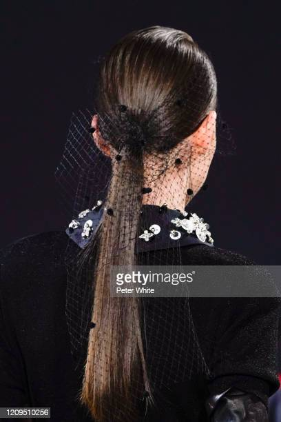 Model, hair detail, walks the runway during the Elie Saab show as part of the Paris Fashion Week Womenswear Fall/Winter 2020/2021 on February 29,...
