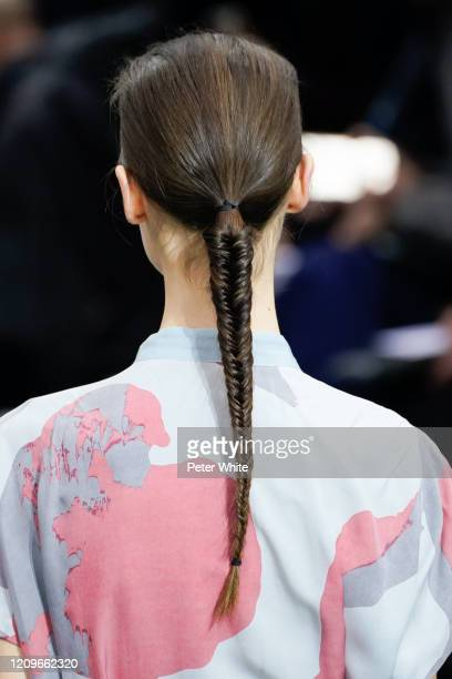 Model, hair detail, walks the runway during the Issey Miyake as part of the Paris Fashion Week Womenswear Fall/Winter 2020/2021 on March 01, 2020 in...