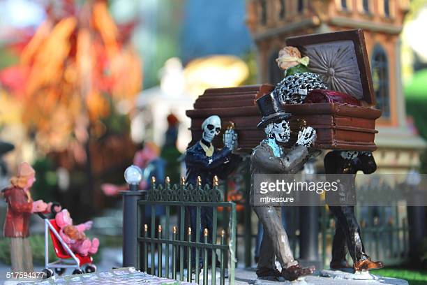 model halloween spooky-town / village, miniatures, skeletons carrying coffin, graveyard cemetery - pallbearer stock photos and pictures