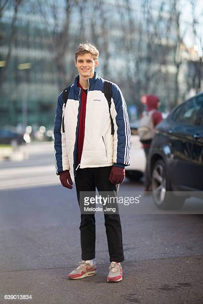 Model Hamish Quigley wears an Adidas jacket black jeans and Nike sneakers during Milan Men's Fashion Week Fall/Winter 2017/18 on January 16 2017 in...