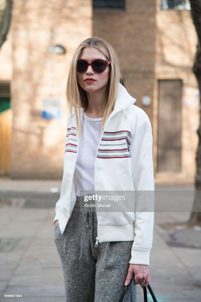 Model Hana Jirickova wears Valentino trousers and a Betty Barkley jacket on day 3 of London Womens Fashion Week Autumn/Winter 2017, on February 19, 2017 in London, England.