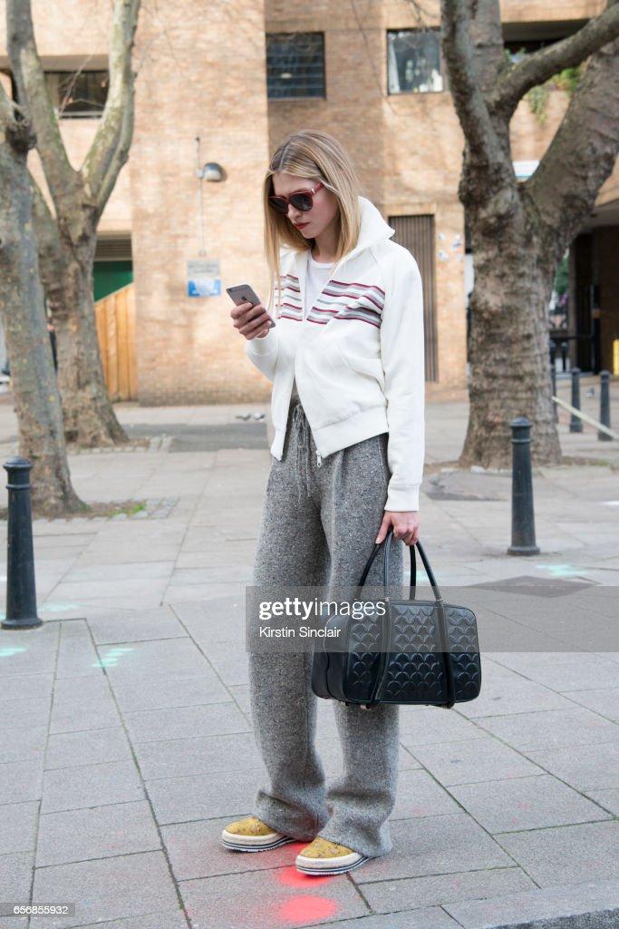 Model Hana Jirickova wears Valentino trousers, Prada shoes and Betty Barkley jacket on day 3 of London Womens Fashion Week Autumn/Winter 2017, on February 19, 2017 in London, England.