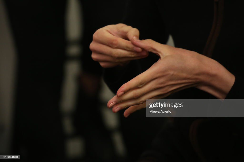 A model, hand detail, prepares backstage for Irina Vitjaz during New York Fashion Week: The Shows at Gallery I at Spring Studios on February 14, 2018 in New York City.