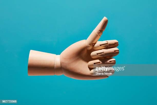 model hand flashes the like symbol - still life foto e immagini stock