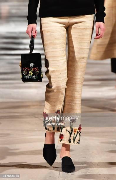 A model handbag and shoe detail walks the runway at Oscar De La Renta fashion show during February 2018 New York Fashion Week at The Cunard Building...