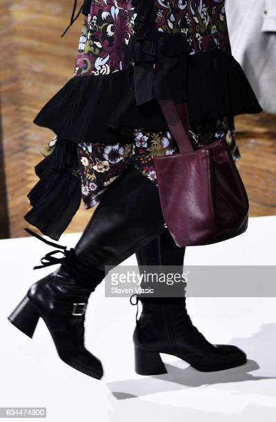 Model handbag and shoe detail walks the runway at the Adeam fashion show during New York Fahion Week at The High Line Hotel on February 9 2017 in New...
