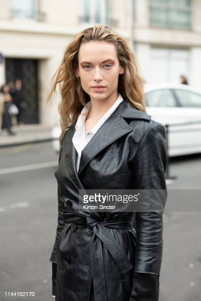 Model Hannah Ferguson wears a black leather trench coat and white shirt on February 28, 2019 in Paris, France.