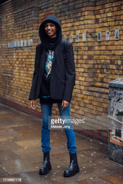 Model Hannah Shakespeare wears a black hoodie, black blazer, blue skinny jeans, and black Chelsea boots after the Fashion East show during London...