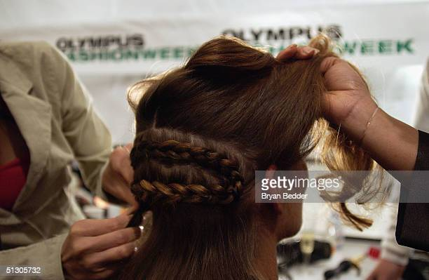 A model has her hair braided backstage at the Reem Acra Couture Spring 2005 fashion show during the Olympus Fashion Week Spring 2005 at the Bryant in...