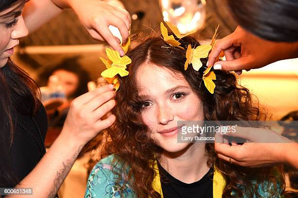 A model has her hair done backstage at the Desigual fashion show during New York Fashion Week The Shows September 2016 at The Arc Skylight at...
