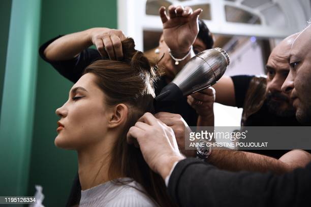 Model has her hair done backstage prior to the Alexis Mabille Women's Spring-Summer 2020/2021 Haute Couture collection fashion show in Paris, on...